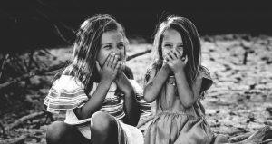 2 girls laughing at night camp