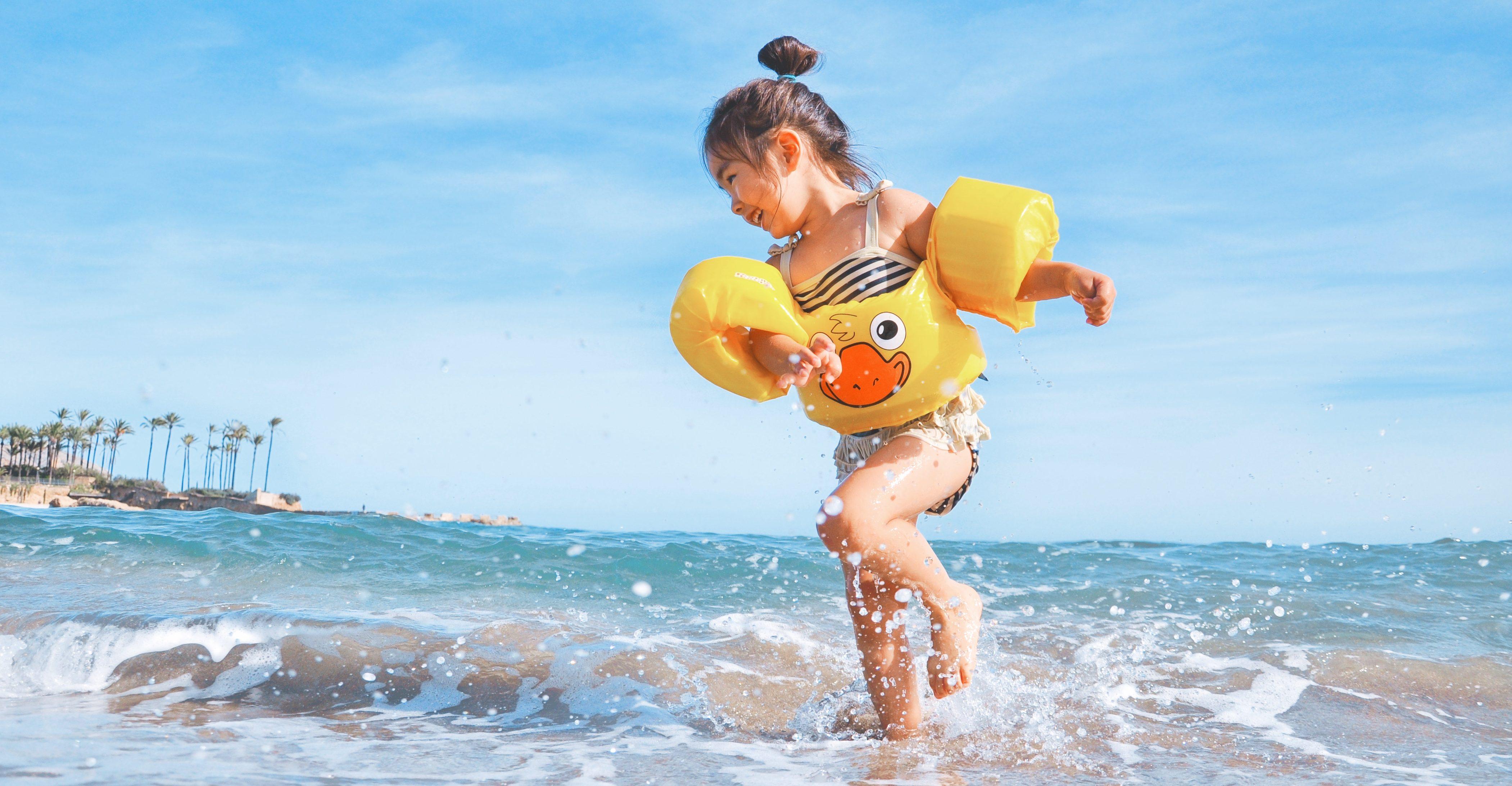 kid girl playing at beach